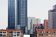 Netherlands, Rotterdam, view to modern office towers and multi-family houses in the foreground - MYF000985