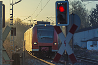 Germany, Juechen, regional train passing railway crossing - FR000234