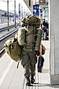 Austria, Linz, soldier of Austrian Armed Forces walking with baggage at platform - EJW000748