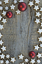 Cinnamon stars and red Christmas baubles - ASF005547