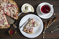 Strawberry rhubarb tart with whipped cream and cup of fruit tea - YFF000364