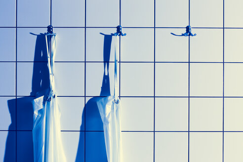 Aprons hanging on coat hooks in dissecting room - DISF001569