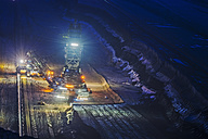 Germany, Juechen, Garzweiler, brown coal mining with lighted bucket-wheel excavator by night - FRF000236