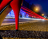 Red high heel and tail lights at night - EJWF000752