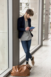 Young businessman using mini tablet - HCF000115