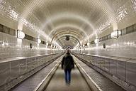 Germany, Hamburg, man walking in Old Elbe Tunnel - BRF001164