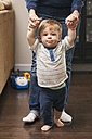 Little boy learning to walk with help from mother - SELF000036