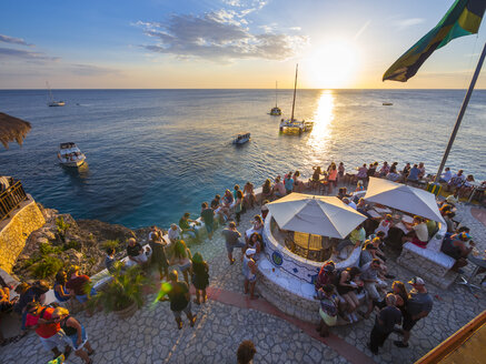 Jamaica, Negril, Rick's Cafe at the coast at sunset - AM003947