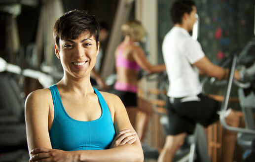 Portrait of smiling woman in a gym - SELF000049