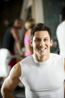 Portrait of smiling man in a gym - SELF000055
