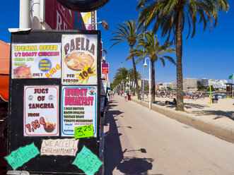 Spain, Baleares, Mallorca, Magaluf, view to beach promenade and offers of a restaurant - AM003956