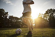 Teenager playing soccer on soccer pitch - GCF000062