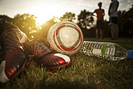 Soccer shoes, ball and bottleof water on soccer pitch - GCF000069