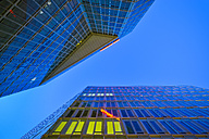 Germany, Hamburg, facades of two office towers at twilight - RJF000422
