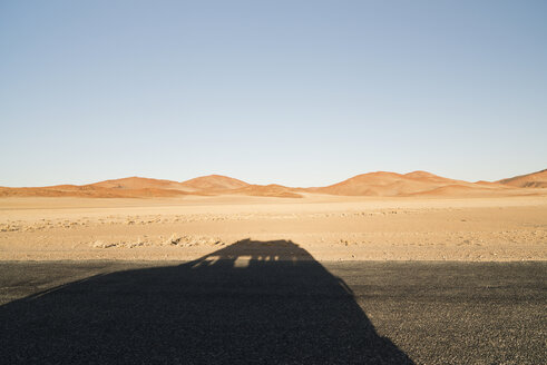 Namibia, Namib Desert, Namib Naukluft Park, shadow of a car driving through Sossusvlei - CLPF000094