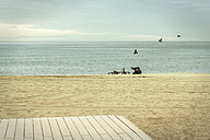 Spain, Barcelona, person relaxing on the beach - GDF000706