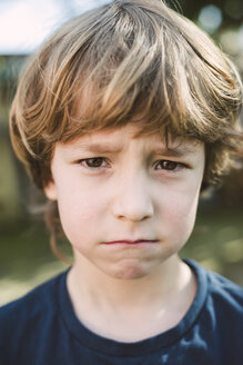 Portrait of little boy pouting mouth - RAEF000133
