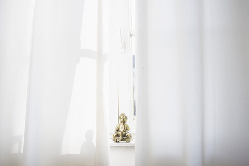 Little Buddha statue on a window sill - RIBF000017