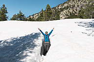 Spain, Catalonia, happy man inside a hole in the snow in the Pyrenees - GEMF000210