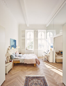 Bedroom in a refurbished old building with dining table in the foreground - DISF002035