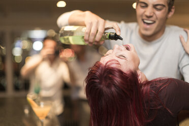 Young man befuddling a woman with alcohol - ZEF005329