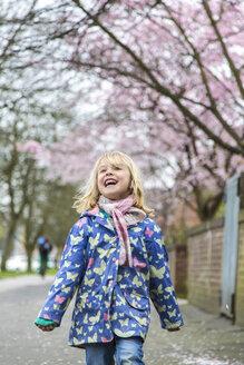 Happy little walking along pavement - JFEF000627