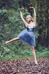 Austria, female dancer in the wood, jumping - DAWF000326