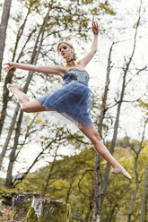 Austria, female dancer in the wood, jumping - DAWF000341
