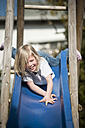 Happy girl on a slide - PAF001299