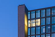 Germany, Baden-Wuerttemberg, Stuttgart, facade of office building at twilight - WDF003081