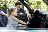 Father showing daughter his car - TOYF000079