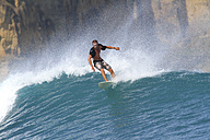 Indonesia, Lombok Island, surfing man - KNTF000010