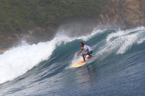 Indonesia, Lombok Island, surfing man - KNTF000011