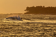 Indonesia, Bali, surfing man at twilight - KNTF000017