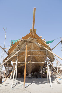 Oman, Sur, dhow under construction at dry dock - HL000866