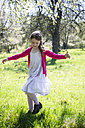 Girl dancing on a meadow in springtime - SARF001745