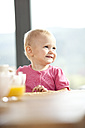 Smiling baby at beakfast table - MFRF000222