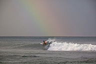 Indonesia, Bali, Surfing a wave - KNTF000029