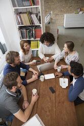 Group of friends meeting in a cafeteria - FKF001016