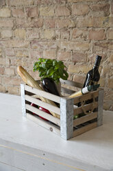 Wooden box with vegetables, pasta, baguette, basil and wine bottle - FKF001034