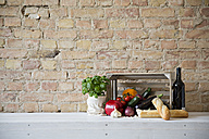 Wooden box with vegetables, baguette, basil and wine bottle - FKF001037