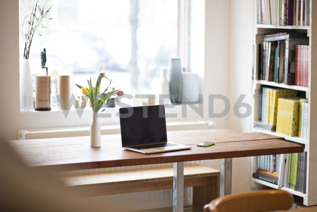 Table with laptop in a modern individual bistro - FKF001050