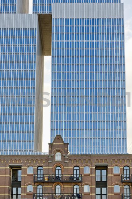 Netherlands, Rotterdam, Kop van Zuid, office building De Rotterdam behind an old brick house - MSF004533