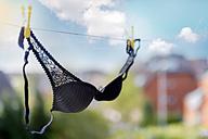 Black bra hanging on clthesline - FRF000251