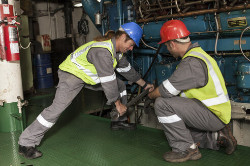Crew working in engine room on a ship - ZEF005474