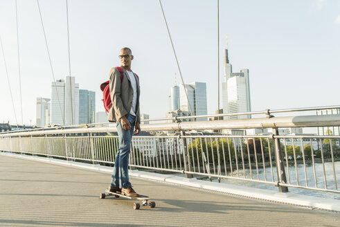 Germany, Frankfurt, man skateboarding on bridge - UUF004045