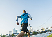 Germany, Frankfurt, man jogging by the riverside - UUF004050