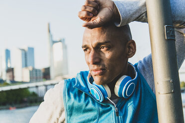 Sportive man with headphones outdoors - UUF004053