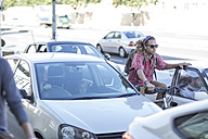 Young man on bicycle in traffic jam - ZEF004674