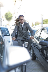 Businessman on bicycle in traffic jam - ZEF004676